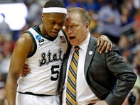 Michigan State Spartans head coach Tom Izzo talks with guard Cassius Winston (5) during the second half.