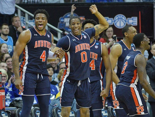 Auburn players celebrate during their defeat of North Carolina in the Sweet 16 of the 2019 NCAA tournament.