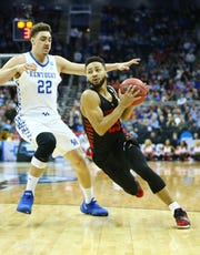 Kentucky forward Reid Travis did not play the last time the Wildcats met Auburn, and the game was still a rout.