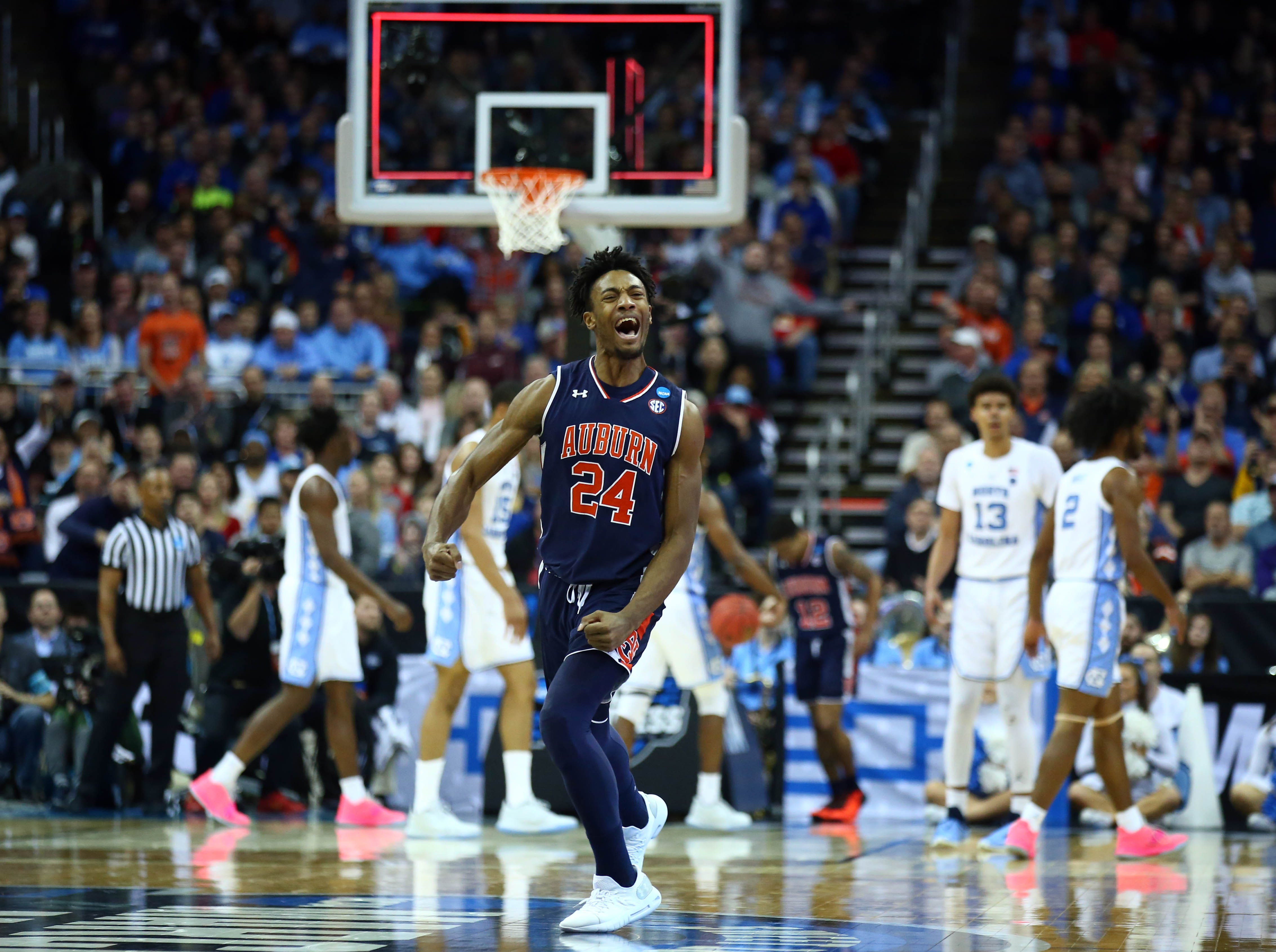 Sweet 16: Auburn forward Anfernee McLemore celebrates after a Tigers basket at the halftime buzzer vs. North Carolina.