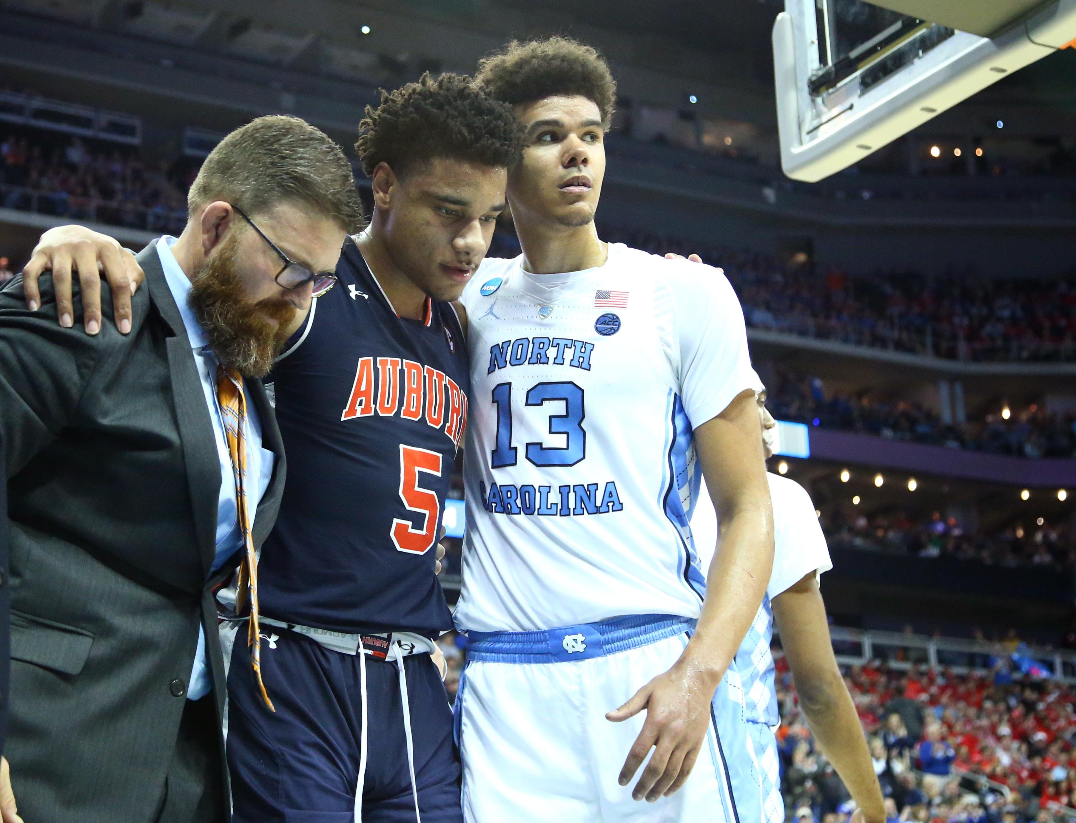 North Carolina Players Embrace Injured Opponent In Great