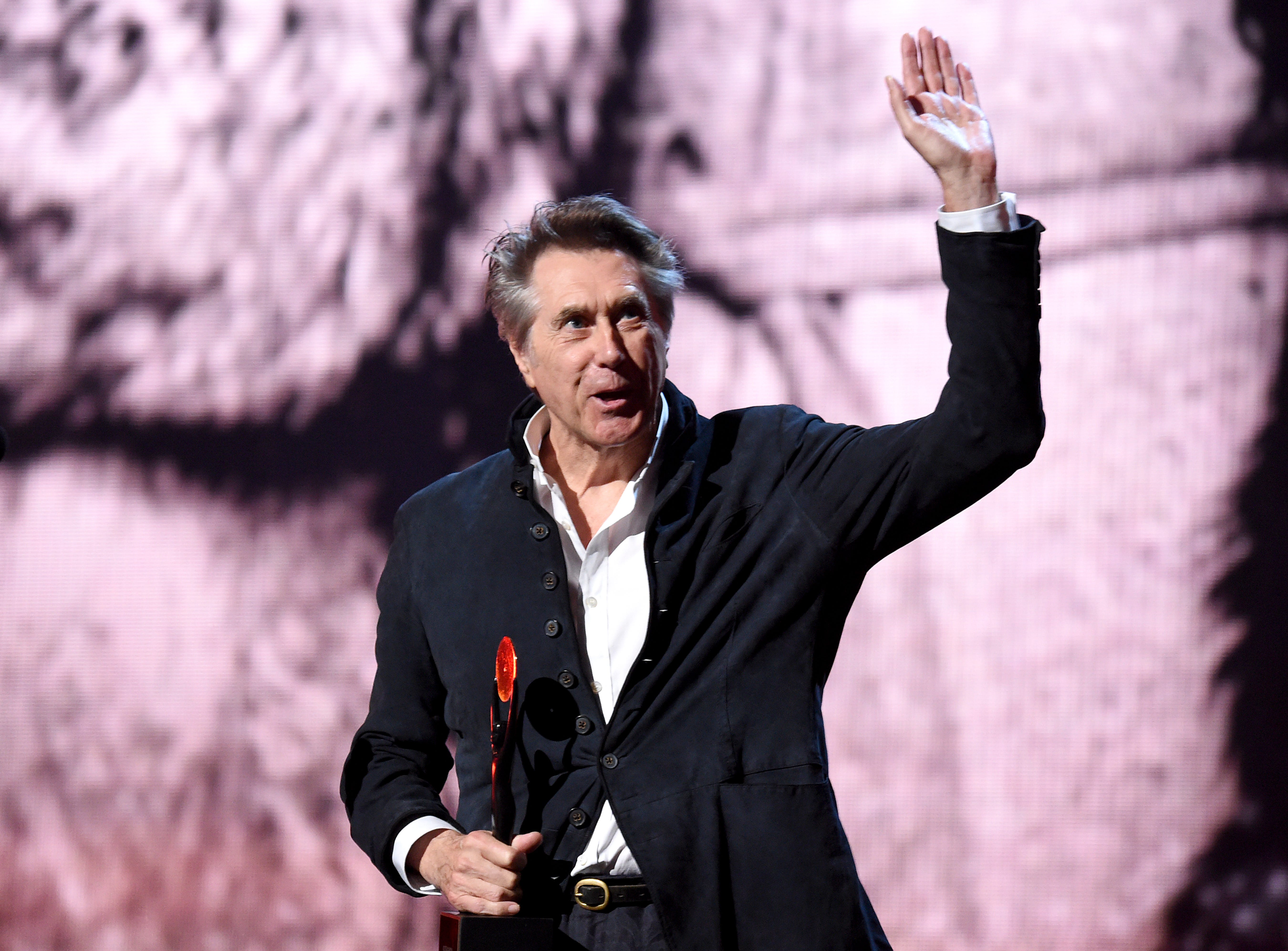 Inductee Bryan Ferry of Roxy Music speaks onstage.
