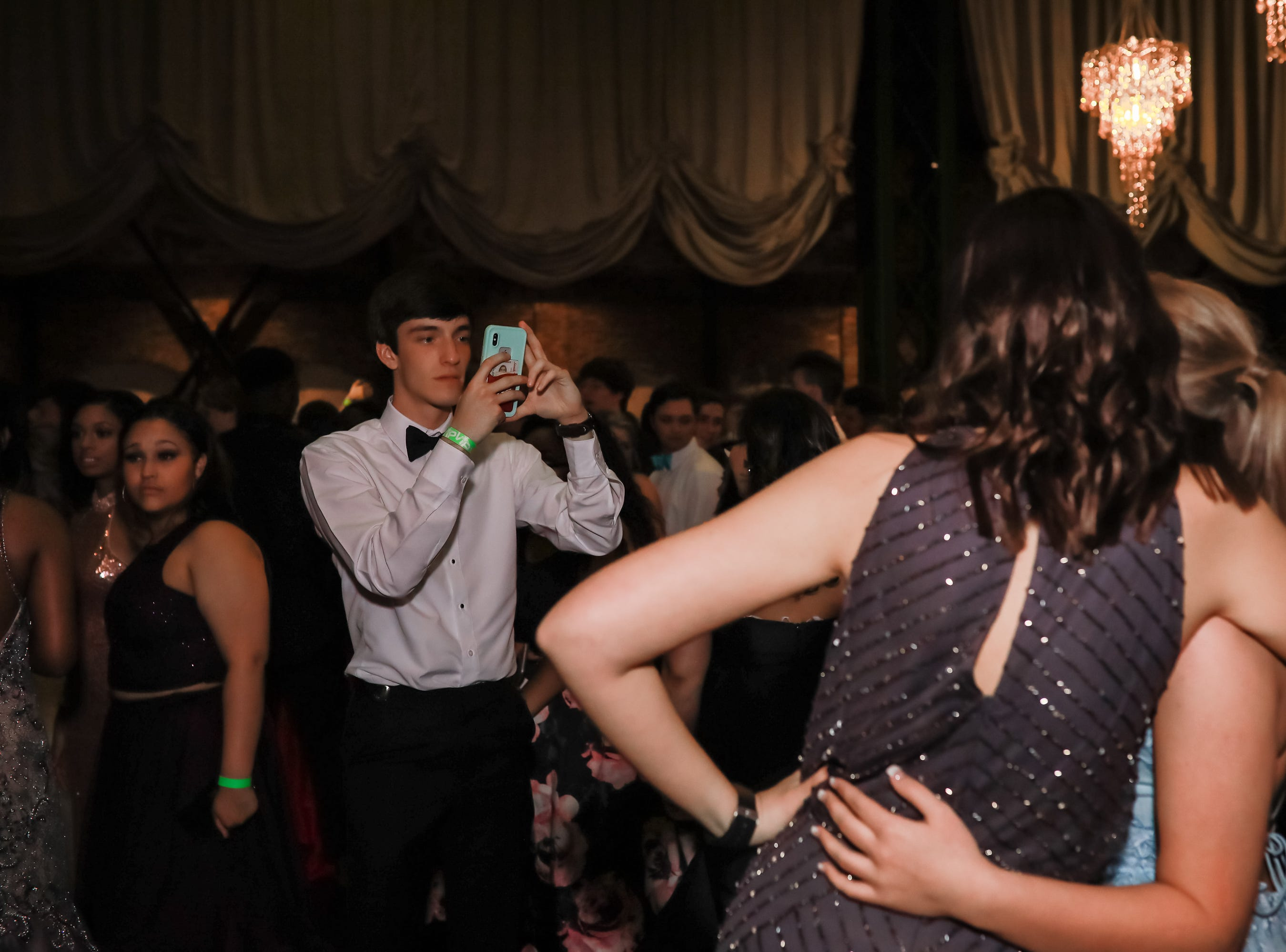 T.L. Hanna High School students enjoy their prom at Bleckley Station in downtown Anderson Saturday, March 30, 2019.