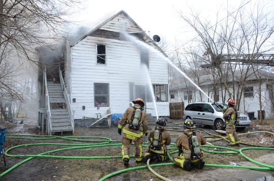 Firefighters attack the blaze from the outside of the apartment house.