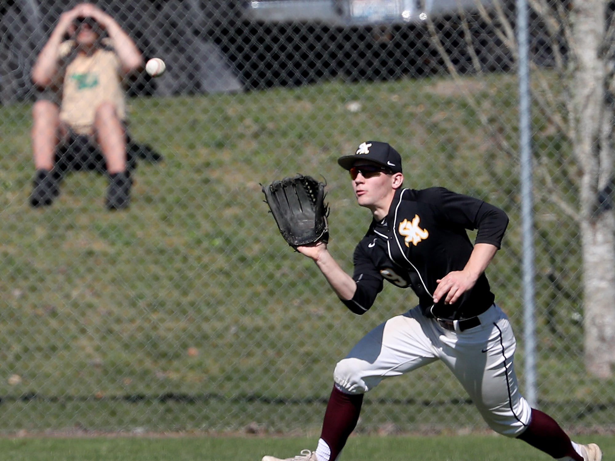 South Kitsap's Sam Canton makes a catch in the outfield during their game against Central Kitsap on Saturday, March 30, 2019.