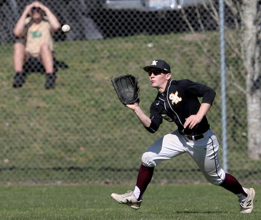 South Kitsap's Sam Canton makes a catch in the outfield during a game against Central Kitsap on March 30. The Wolves sported a 6-3 record heading into Thursday's game at Puyallup.