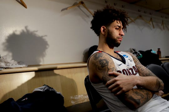 Gonzaga guard Josh Perkins talks to the media after the team's loss to Texas Tech during the West Regional final in the NCAA men's college basketball tournament Saturday, March 30, 2019, in Anaheim, Calif. Texas Tech won 75-69.