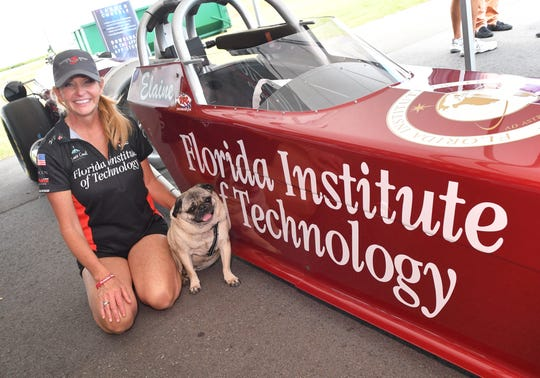 Jet car racer Elaine Larsen and her pug Nitro pose for the camera at the 2019 Melbourne Air & Space Show at the Orlando Melbourne International Airport. Larsen was featured on an insurance commercial during the World Series.