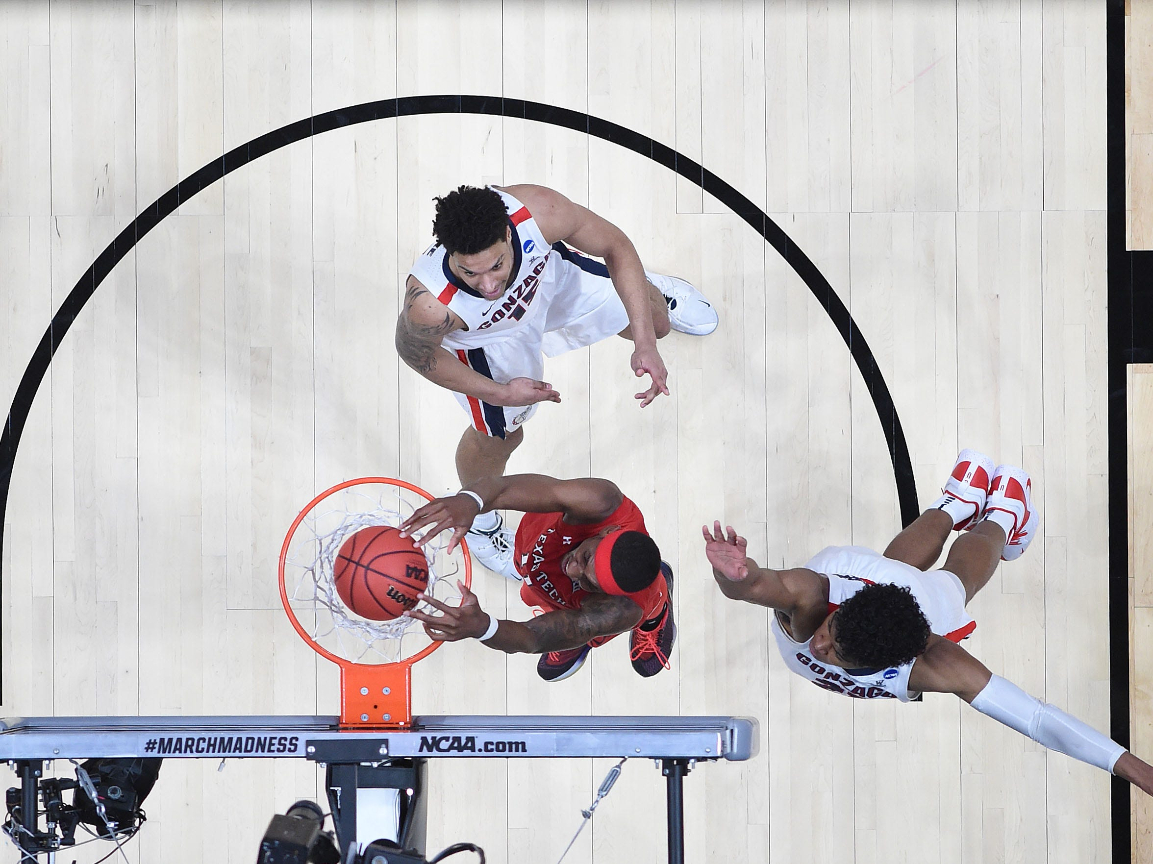 March 30, 2019; Anaheim, CA, USA; Texas Tech Red Raiders forward Tariq Owens (11) scores a basket ahead of Gonzaga Bulldogs forward Rui Hachimura (21) during the second half in the championship game of the west regional of the 2019 NCAA Tournament at Honda Center. Mandatory Credit: Richard Mackson-USA TODAY Sports