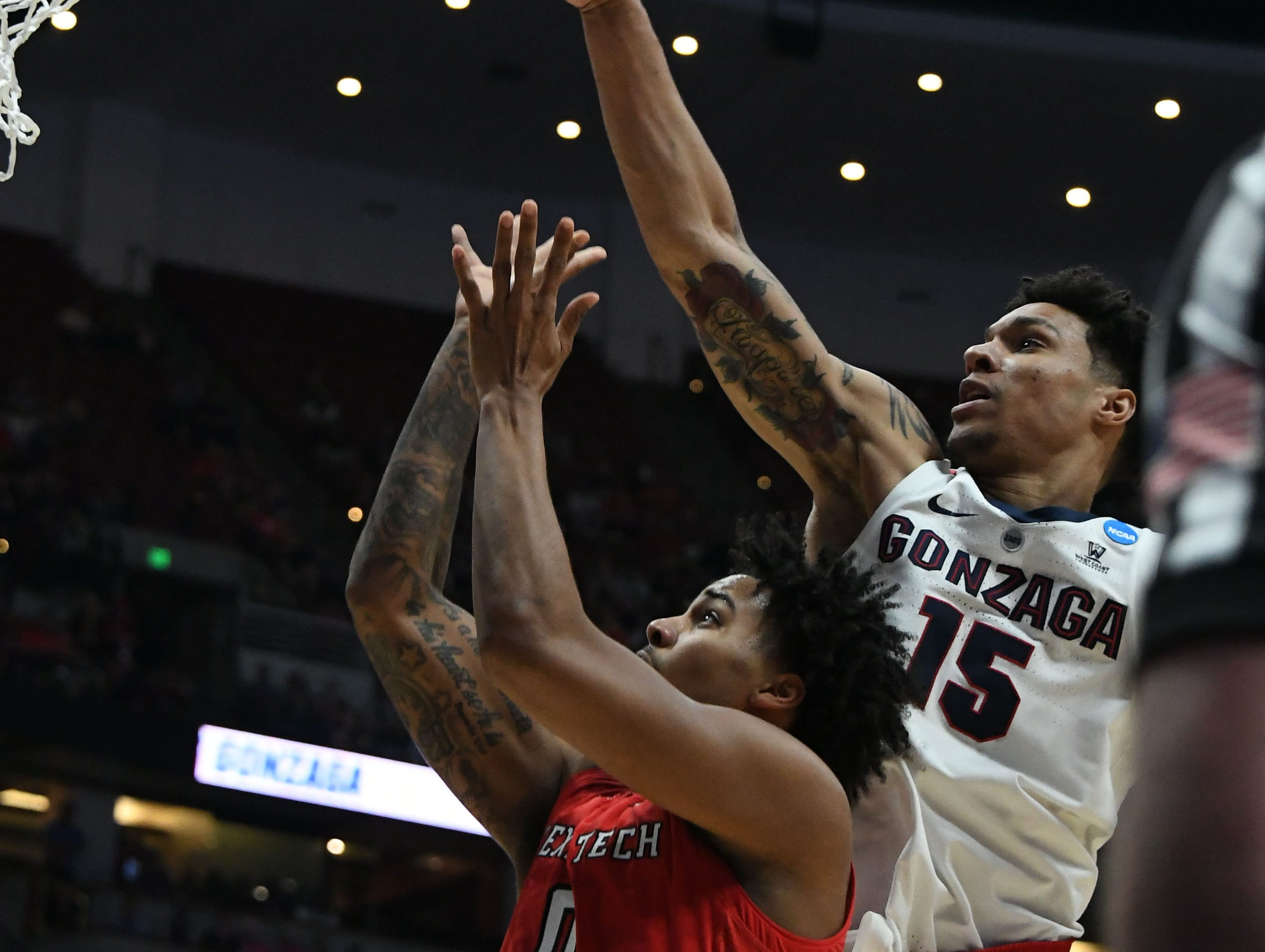 March 30, 2019; Anaheim, CA, USA; Gonzaga Bulldogs forward Brandon Clarke (15) blocks a shot against Texas Tech Red Raiders guard Kyler Edwards (0) during the second half in the championship game of the west regional of the 2019 NCAA Tournament at Honda Center. Mandatory Credit: Richard Mackson-USA TODAY Sports