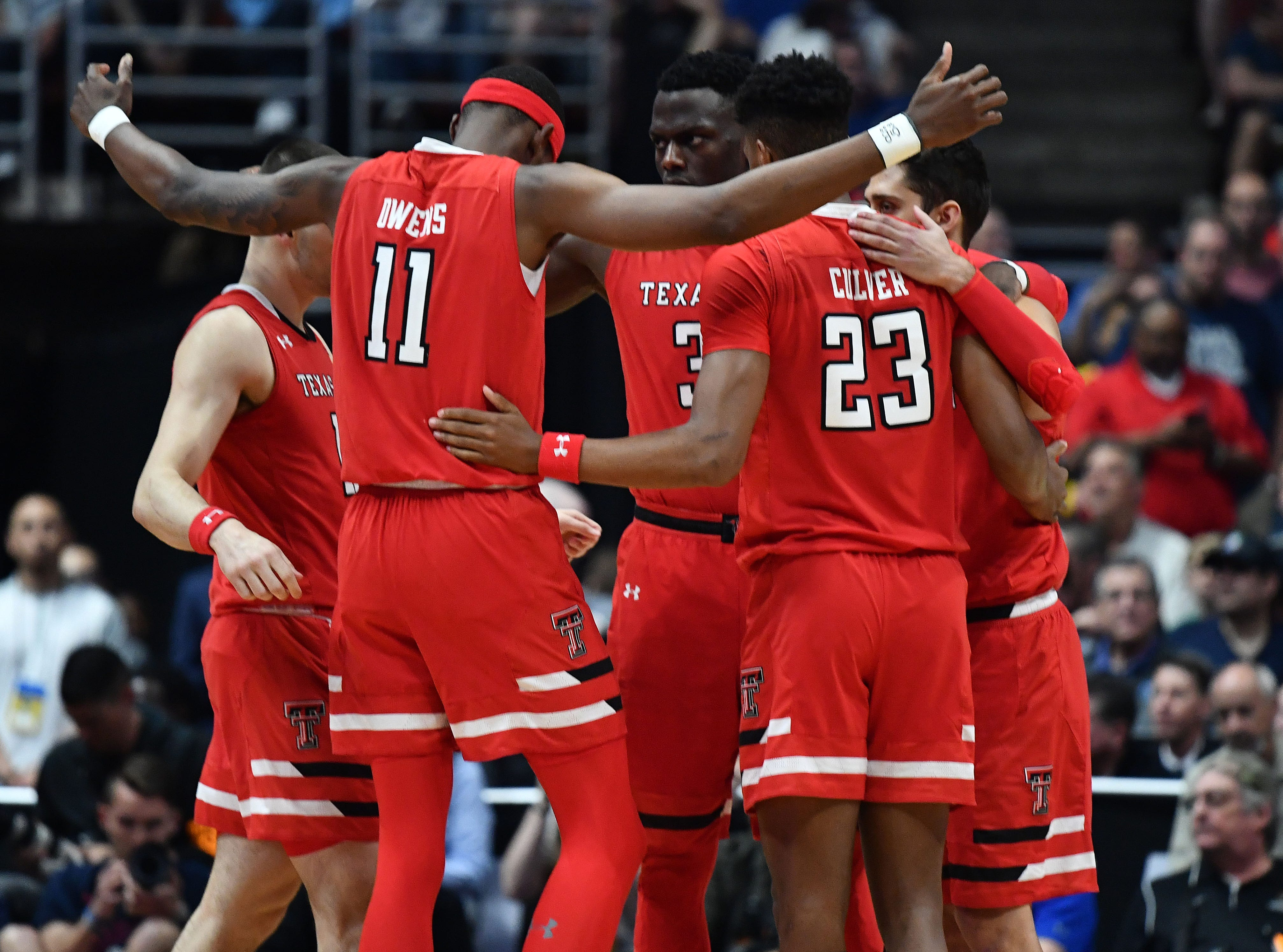 March 30, 2019; Anaheim, CA, USA; Texas Tech Red Raiders forward Tariq Owens (11) and players gather before playing against Gonzaga Bulldogs in the championship game of the west regional of the 2019 NCAA Tournament at Honda Center. Mandatory Credit: Robert Hanashiro-USA TODAY Sports