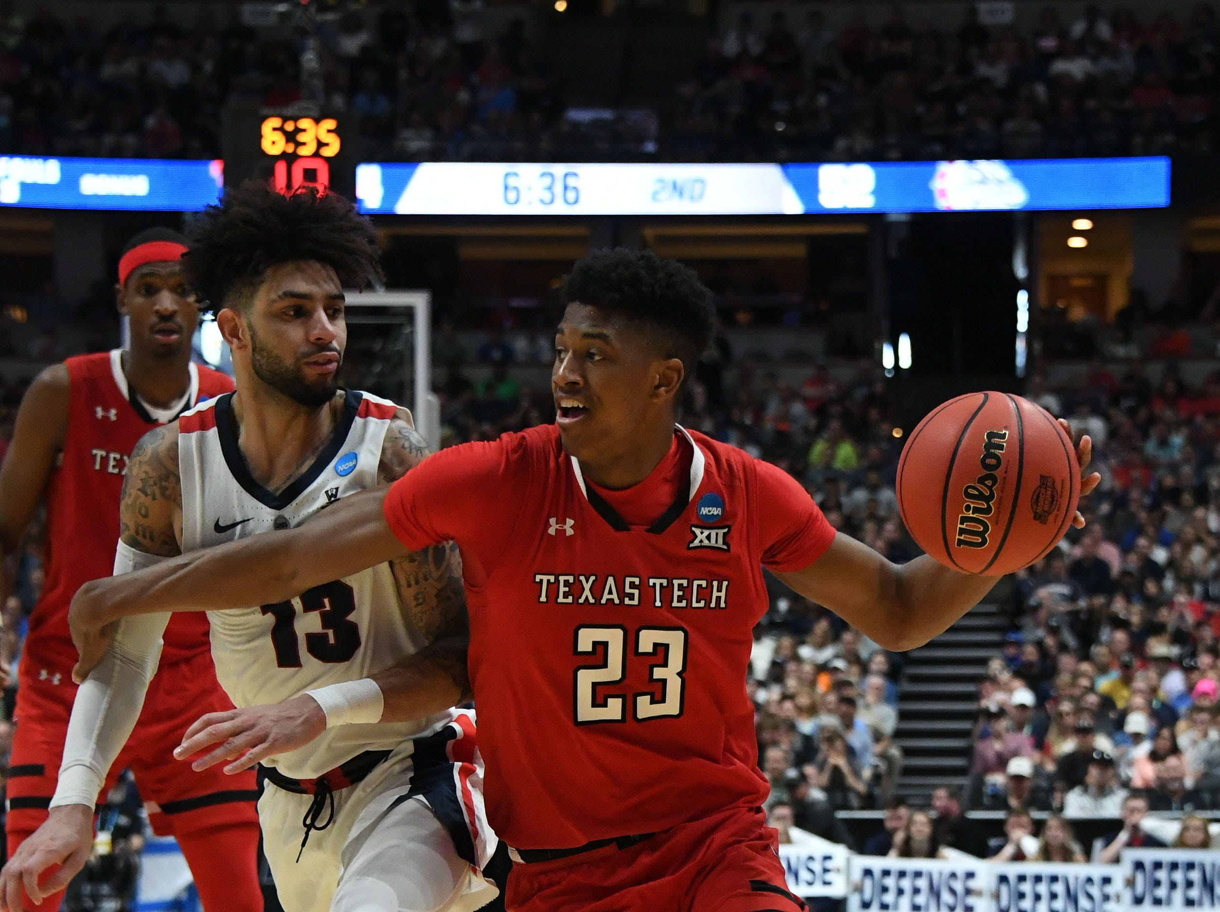March 30, 2019; Anaheim, CA, USA; Texas Tech Red Raiders guard Jarrett Culver (23) moves the ball against Gonzaga Bulldogs guard Josh Perkins (13) during the second half in the championship game of the west regional of the 2019 NCAA Tournament at Honda Center. Mandatory Credit: Richard Mackson-USA TODAY Sports