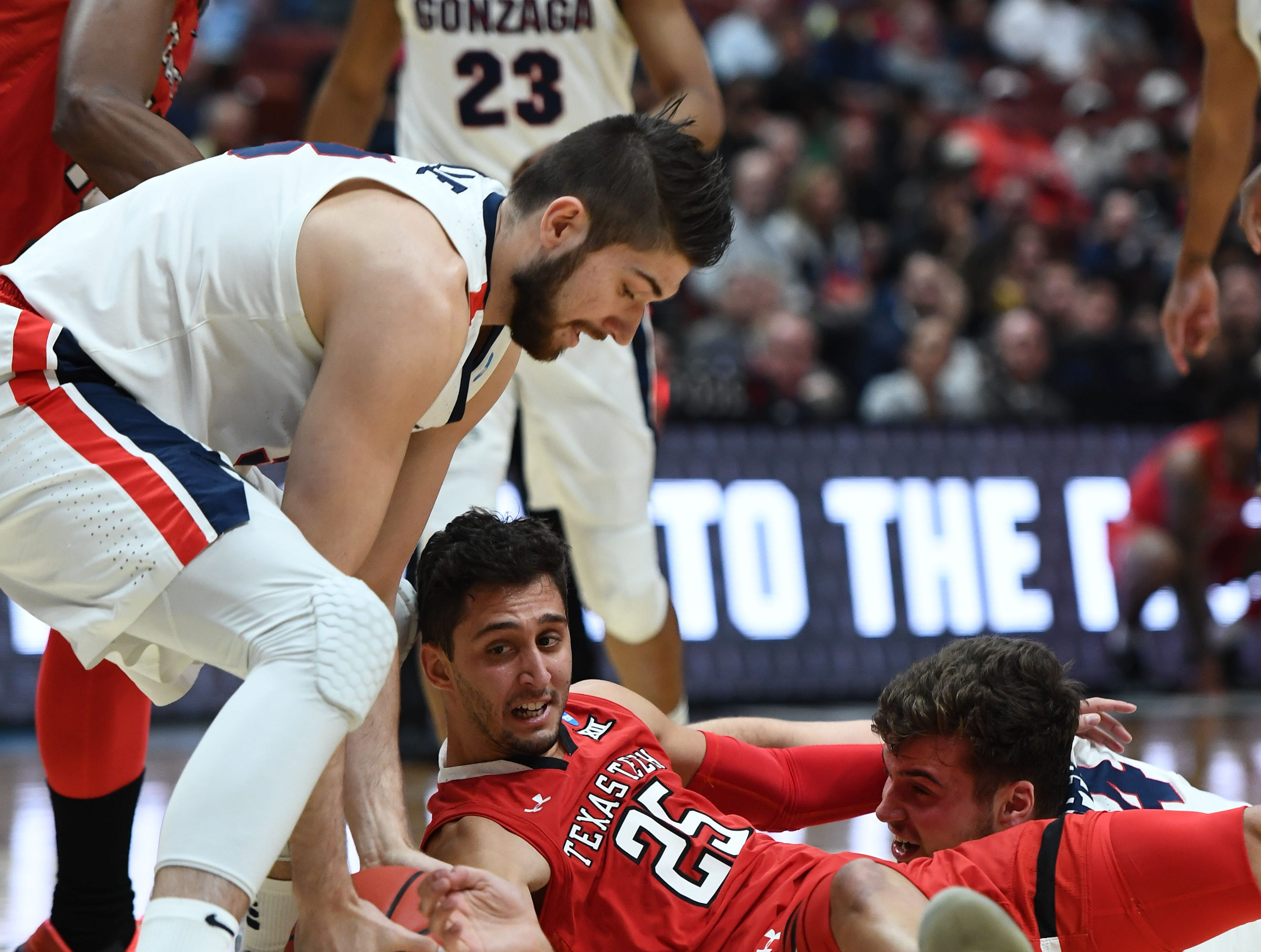 March 30, 2019; Anaheim, CA, USA; Gonzaga Bulldogs forward Killian Tillie (33) plays for the ball against Texas Tech Red Raiders guard Davide Moretti (25) during the first half in the championship game of the west regional of the 2019 NCAA Tournament at Honda Center. Mandatory Credit: Robert Hanashiro-USA TODAY Sports