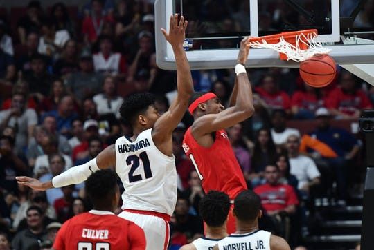 March 30, 2019; Anaheim, CA, USA; Texas Tech Red Raiders forward Tariq Owens (11) scores a basket ahead of Gonzaga Bulldogs forward Rui Hachimura (21) during the second half in the championship game of the west regional of the 2019 NCAA Tournament at Honda Center. Mandatory Credit: Robert Hanashiro-USA TODAY Sports