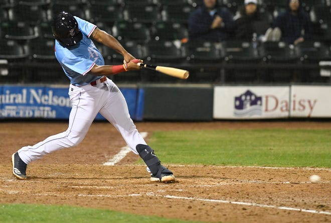Hooks catcher Chuckie Robinson hits against the Round Rock Express in an exhibition game, Saturday, March 30, 2019, at Whataburger Field.