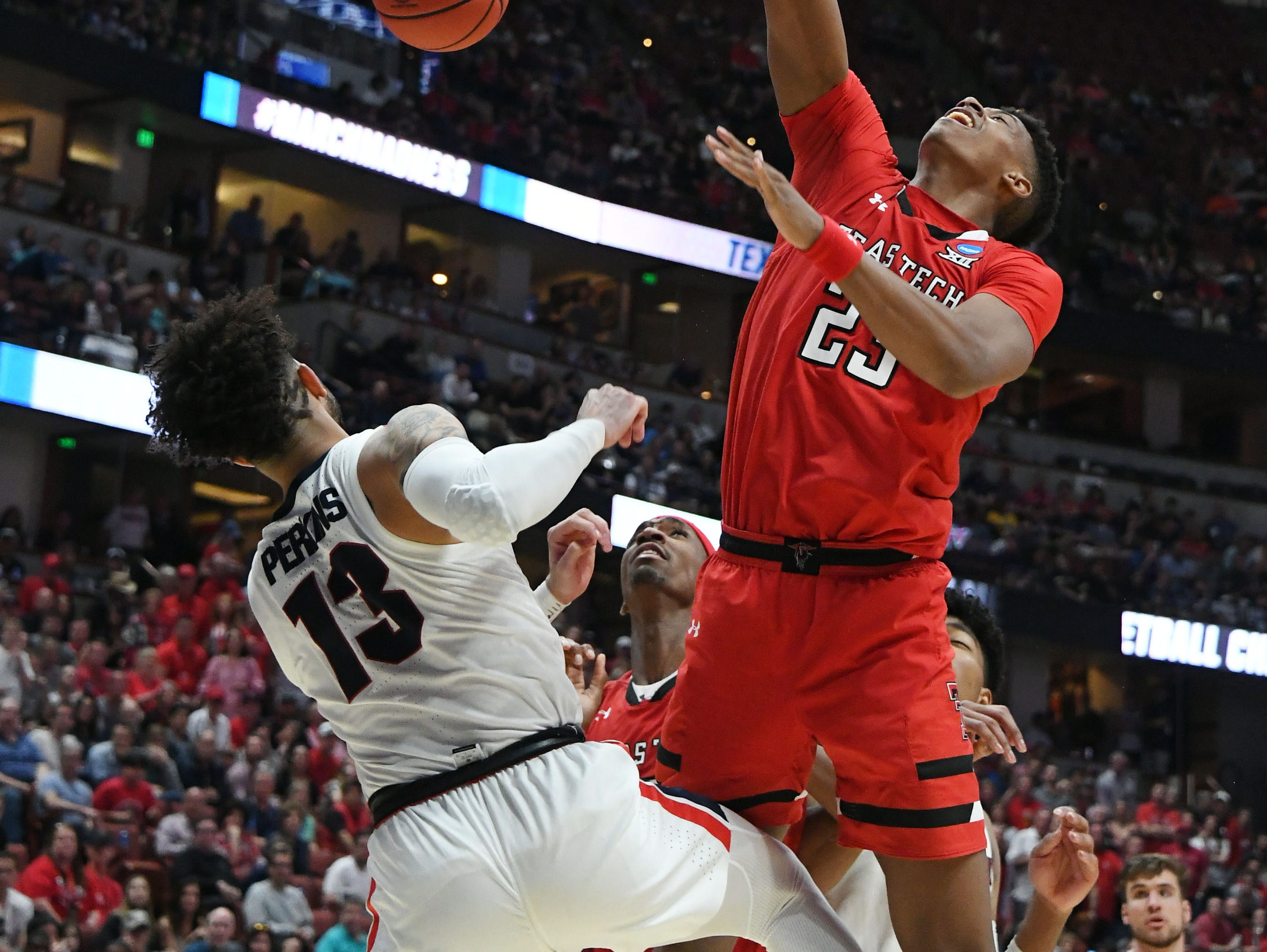 March 30, 2019; Anaheim, CA, USA; Texas Tech Red Raiders guard Jarrett Culver (23) dunks to score a basket against Gonzaga Bulldogs guard Josh Perkins (13) during the second half in the championship game of the west regional of the 2019 NCAA Tournament at Honda Center. Mandatory Credit: Richard Mackson-USA TODAY Sports