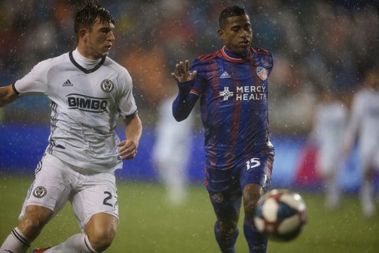 Philadelphia Union defender Kai Wagner (27) and FC Cincinnati midfielder Allan Cruz (15) chase the ball down in the first half of the match between FC Cincinnati and Philadelphia Union on Saturday, March 30, 2019, at Nippert Stadium in Cincinnati.