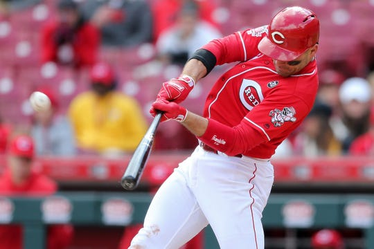 Cincinnati Reds first baseman Joey Votto hits a double in the ninth inning of an MLB baseball game against the Pittsburgh Pirates, Sunday, March 31, 2019, at Great American Ball Park in Cincinnati.