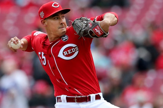 Cincinnati Reds starting pitcher Robert Stephenson delivers in the eighth inning of an MLB baseball game against the Pittsburgh Pirates, Sunday, March 31, 2019, at Great American Ball Park in Cincinnati.