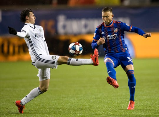 FC Cincinnati midfielder Caleb Stanko (33) and Philadelphia Union midfielder Brenden Aaronson (22) compete for the ball in the second half of the match between FC Cincinnati and Philadelphia Union on Saturday, March 30, 2019, at Nippert Stadium in Cincinnati.