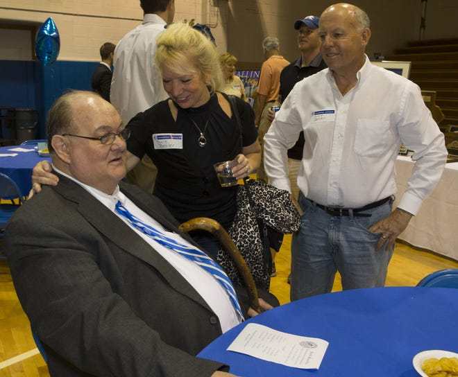 Jack Kaelin talks with former student Mark Behler and his wife Janie during a retirement ceremony held for him May 3, 2013.