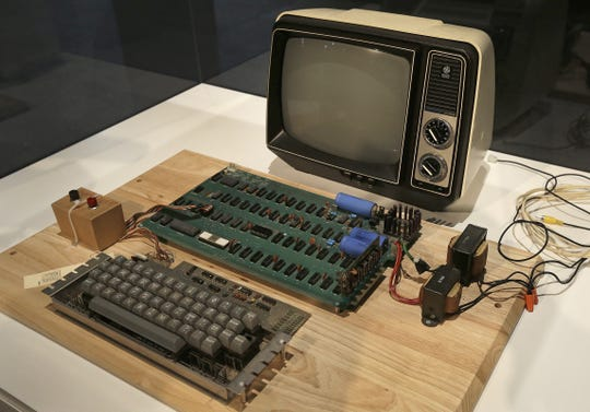 Ben Margot,  AP An Apple 1 computer designed and sold by Steve Jobs and Steve Wozniak in 1976 was the humble beginning of the Apple, Inc. empire.