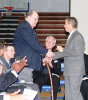 Longtime official scorer Jack Kaelin gets his state championship ring from Dave Kathman as CovCath celebrated its 2014 state championship in basketball.