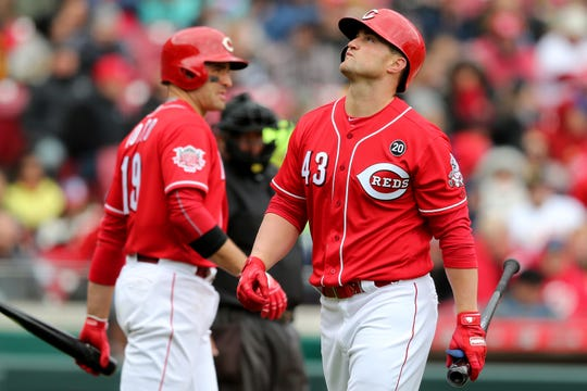 Cincinnati Reds right fielder Scott Schebler (43) reacts after striking out in the sixth inning of an MLB baseball game against the Pittsburgh Pirates, Sunday, March 31, 2019, at Great American Ball Park in Cincinnati.