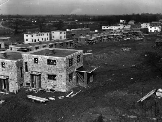 The Greenhills housing under construction in April 1937 opened to residents on April 1, 1938.