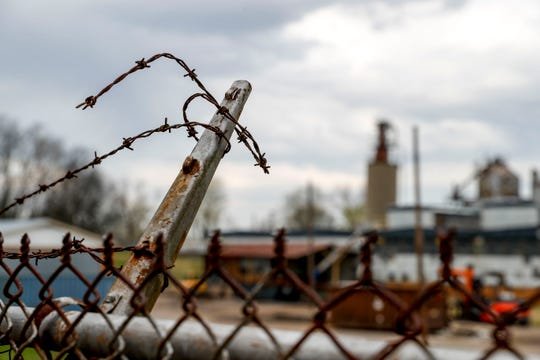 Cut and rusted barbed wire sprawl on top of the fence where Vulcan used to have a manufacturing site can be seen at the Vulcan Corporation off of College Street in Clarksville, Tenn., on Friday, March 29, 2019.