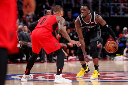 Reggie Jackson dribbles against Damian Lillard in the second half.