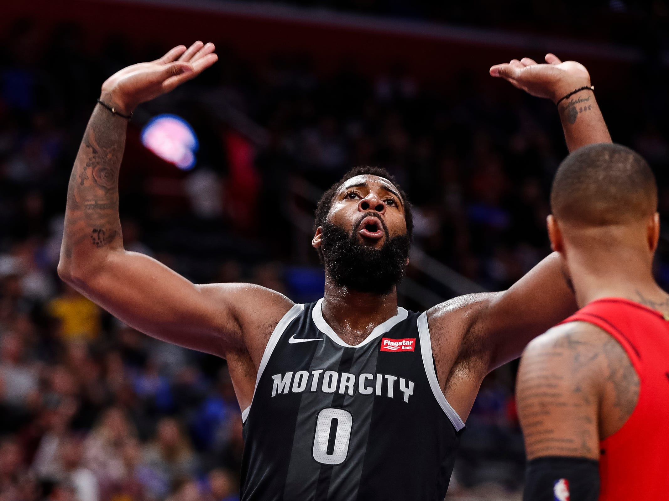 Pistons center Andre Drummond (0) celebrates a dunk against Trail Blazers during the second half of the Pistons' 99-90 win over the Trail Blazers on Saturday, March 30, 2019, at Little Caesars Arena.
