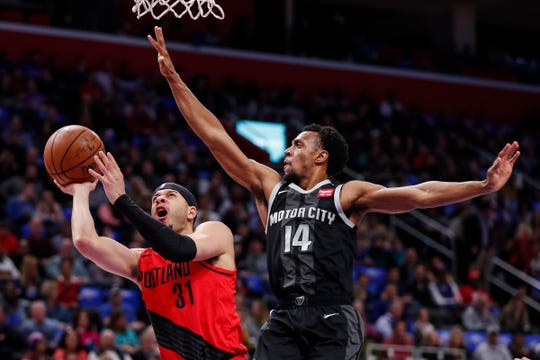 Trail Blazers guard Seth Curry (31) shoots against Pistons  guard Ish Smith (14) during the first half at the Little Caesars Arena in Detroit, Saturday, March 30, 2019.