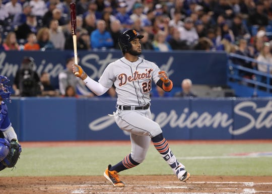 Tigers second baseman Niko Goodrum hits a double in the eighth inning of the Tigers' 4-3 win in Toronto, Sunday, March 31, 2019.