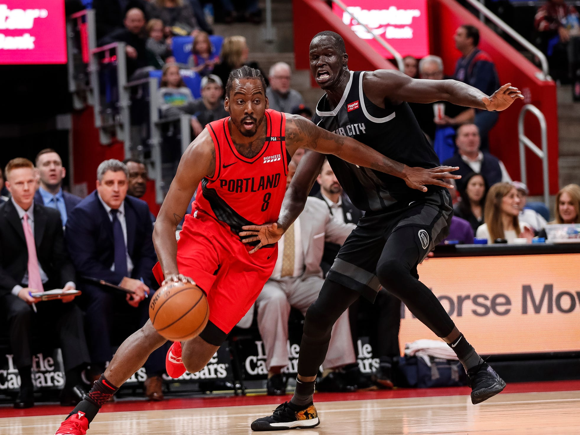 Portland Trail Blazers forward Al-Farouq Aminu drives against Detroit Pistons forward Thon Maker during the first half at the Little Caesars Arena, March 30, 2019.