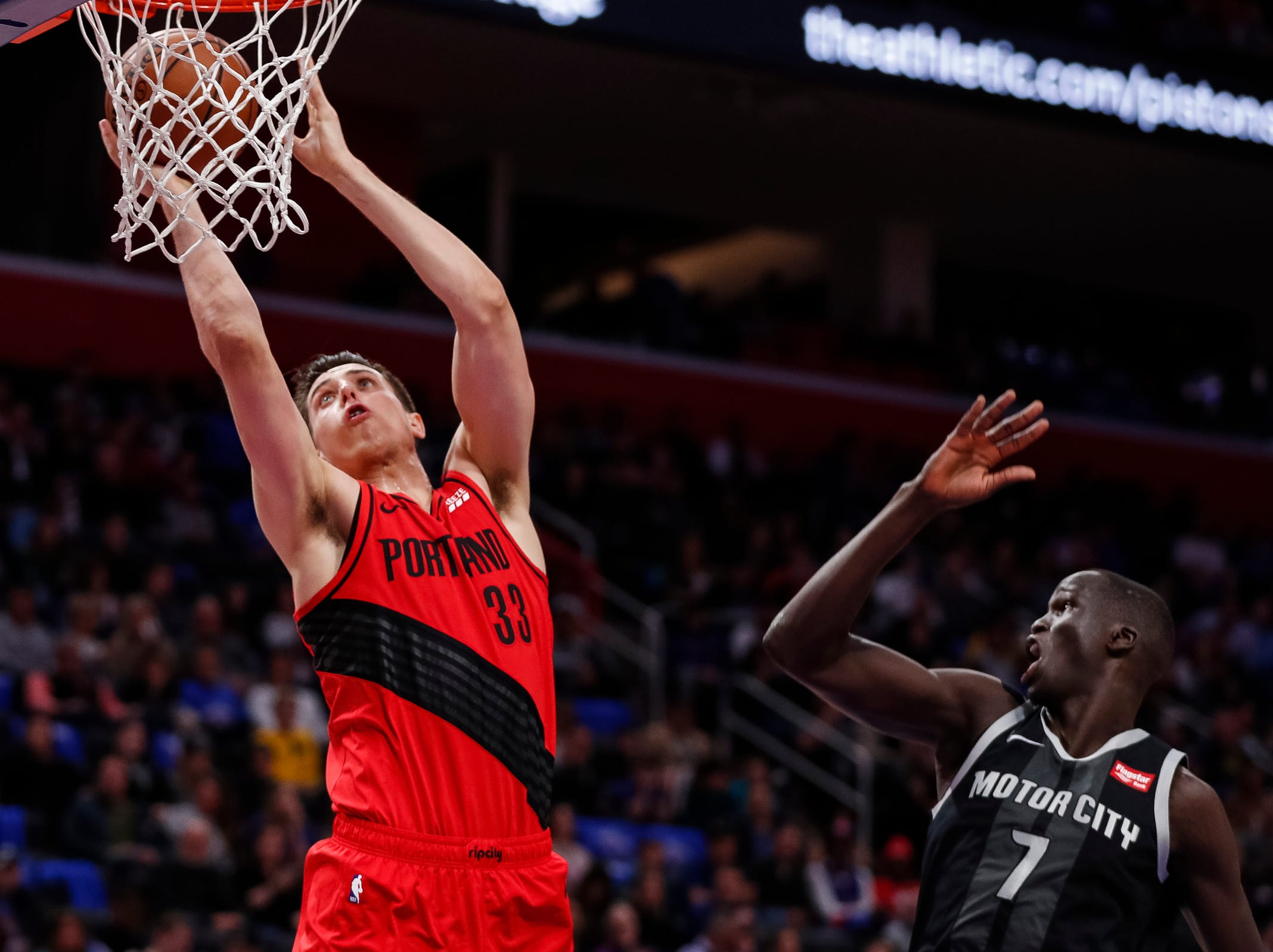 Trail Blazers forward Zach Collins (33) dunks against Pistons forward Thon Maker (7) during the first half at the Little Caesars Arena in Detroit, Saturday, March 30, 2019.