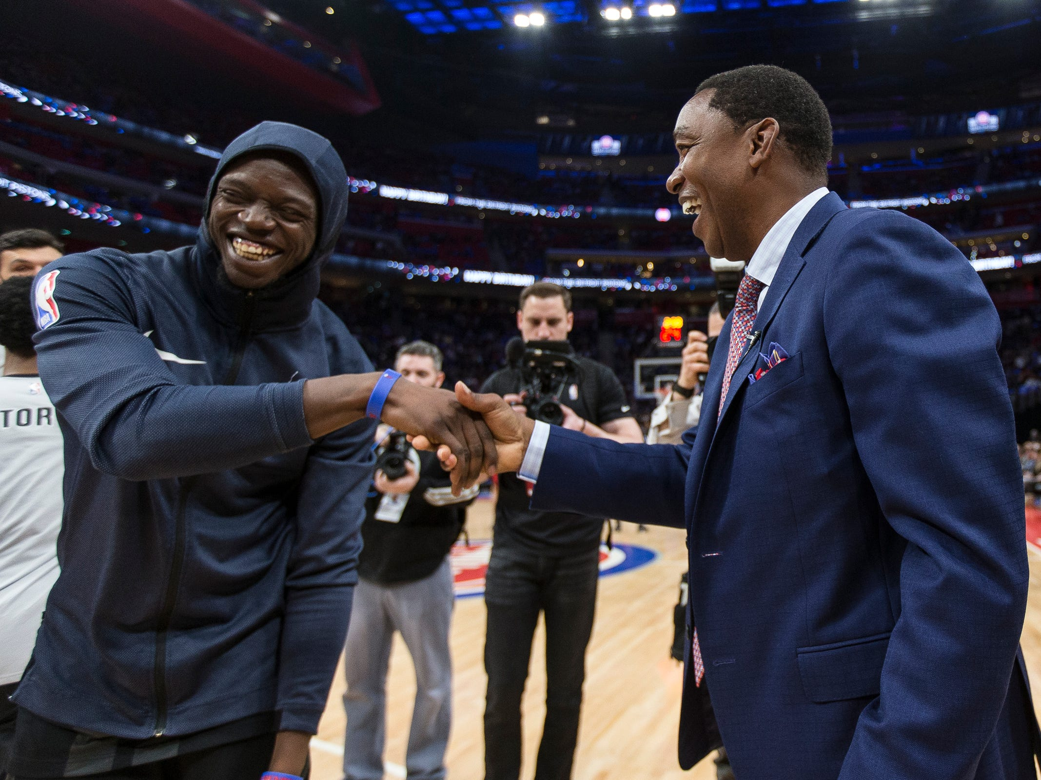 Isiah Thomas high fives guard Reggie Jackson during theÊcelebration for the Bad Boys' 30th anniversary of the 1989-90 back-to-back championships at the Little Caesars Arena in Detroit, Saturday, March 30, 2019.