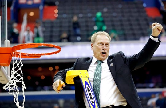 Tom Izzo celebrates by cutting the nets after knocking off Duke.