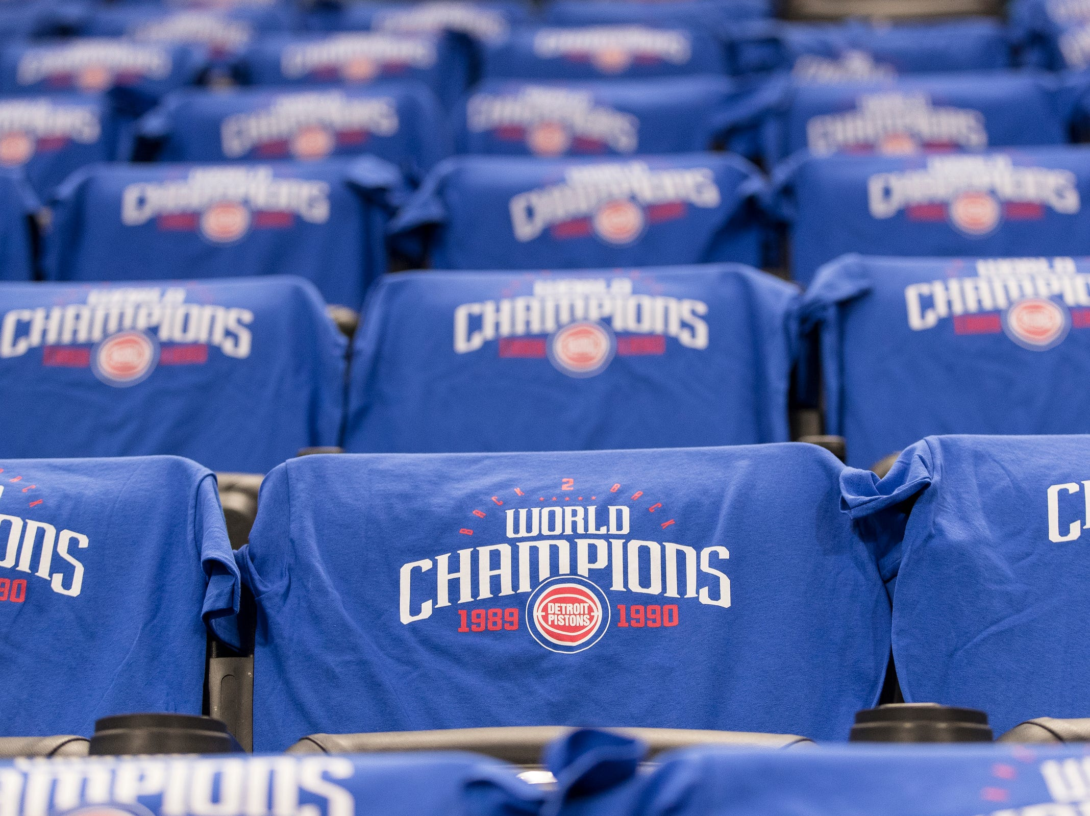 Commemorative give away t-shirts for fans to honor the 1989-90 NBA championship at the Little Caesars Arena in Detroit, Saturday, March 30, 2019.