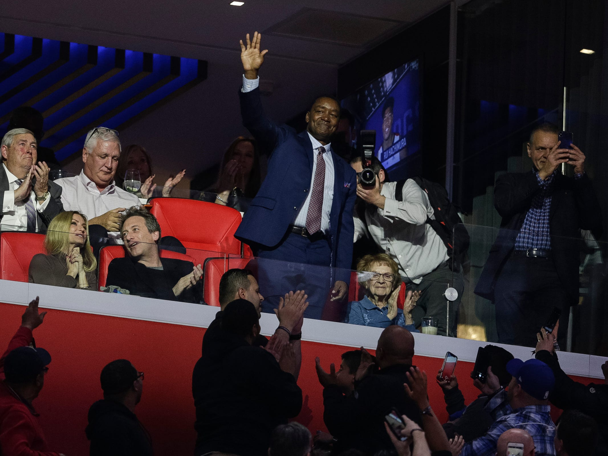 Isiah Thomas waves at the fans as he's been introduced during the first half of Pistons-Trail Blazers game at the Little Caesars Arena in Detroit, Saturday, March 30, 2019.