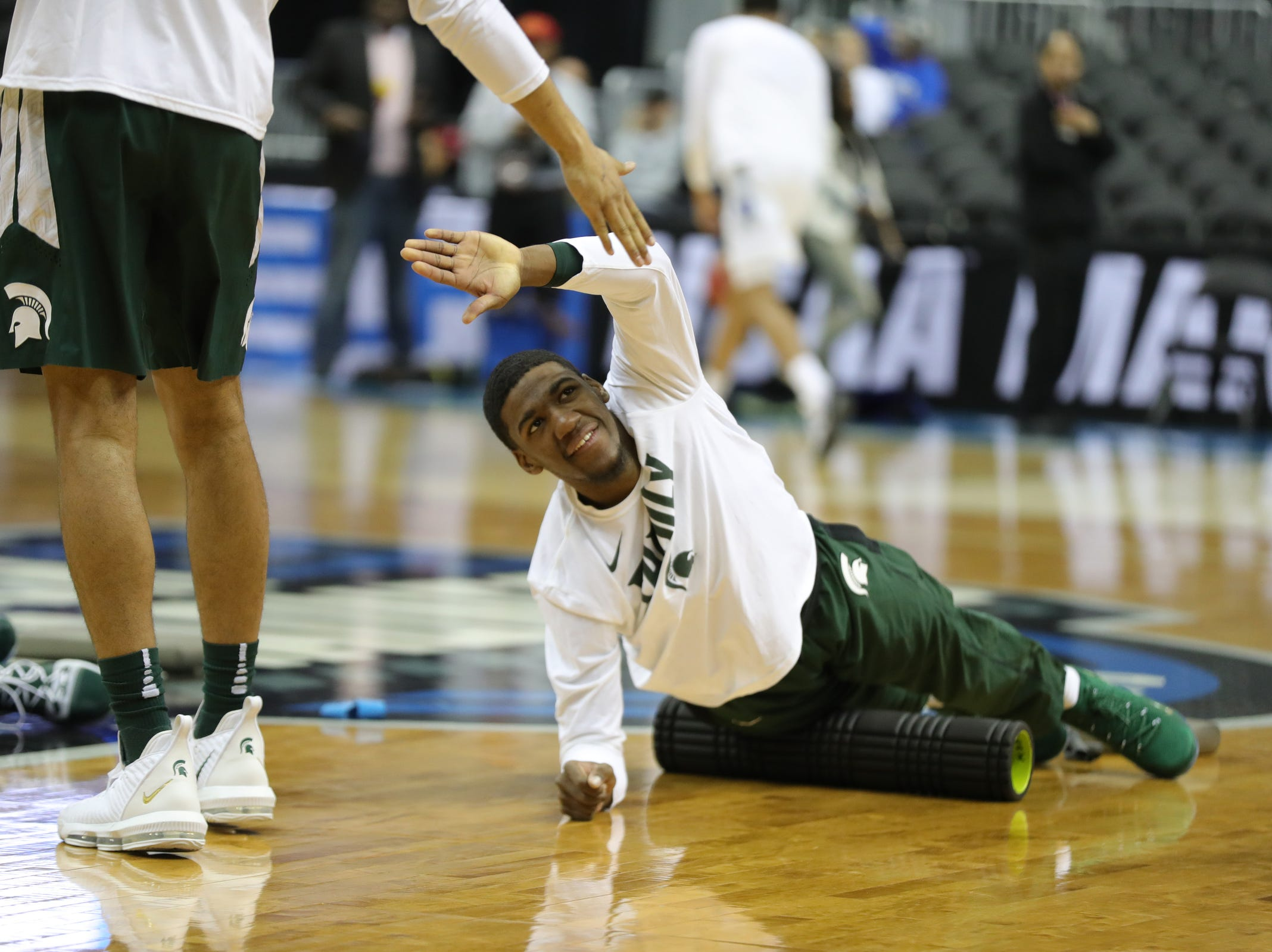 MSU forward Aaron Henry warms up before East Region final against Duke on Sunday, March 31, 2019, in Washington.