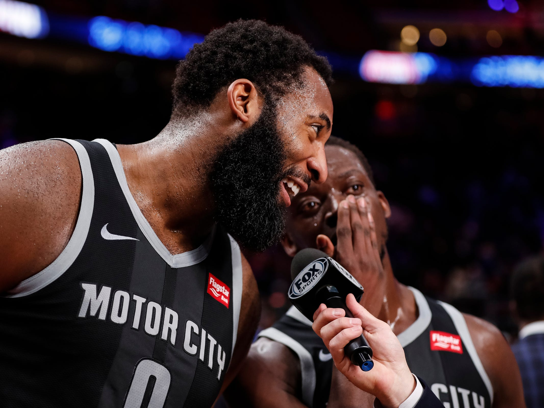 Reggie Jackson, right, whispers to teammate Andre Drummond during the postgame interview after the Detroit Pistons' 99-90 win over the Portland Trail Blazers on Saturday, March 30, 2019, at Little Caesars Arena.