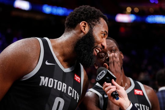 Reggie Jackson, right, whispers to Andre Drummond during the postgame interview after the Pistons' 99-90 win over the Blazers in Detroit.