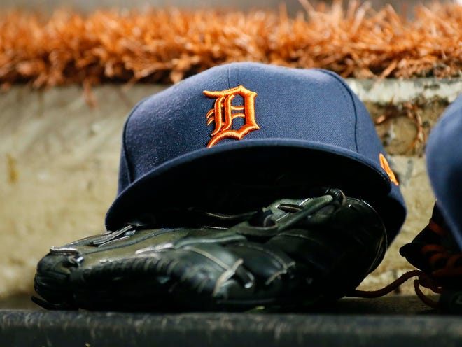 The hat and glove of a Detroit Tigers player before a game against the Toronto Blue Jays at Rogers Centre, March 30, 2019.
