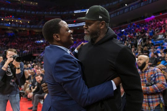 Isiah Thomas talks to Ben Wallace during the Pistons' ceremony for the 30th anniversary of the1989-90 back-to-back championships at the Little Caesars Arena in Detroit, Saturday, March 30, 2019.