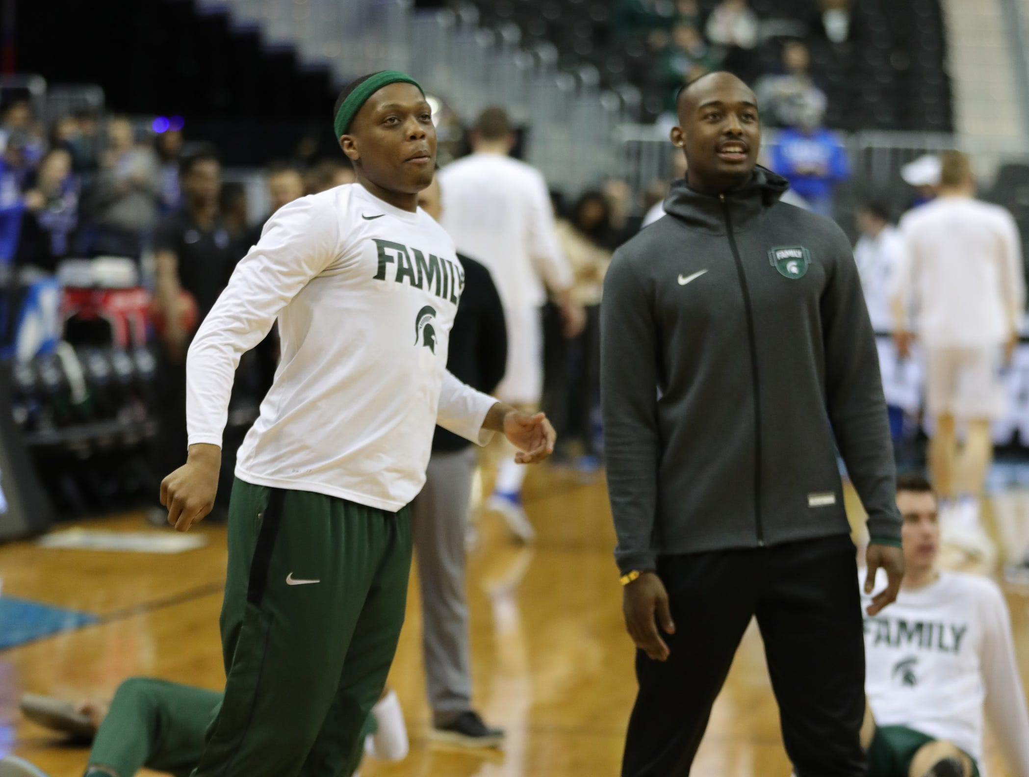 Joshua Langford watches as MSU guard Cassius Winston warms up before East Region final against Duke on Sunday, March 31, 2019, in Washington.