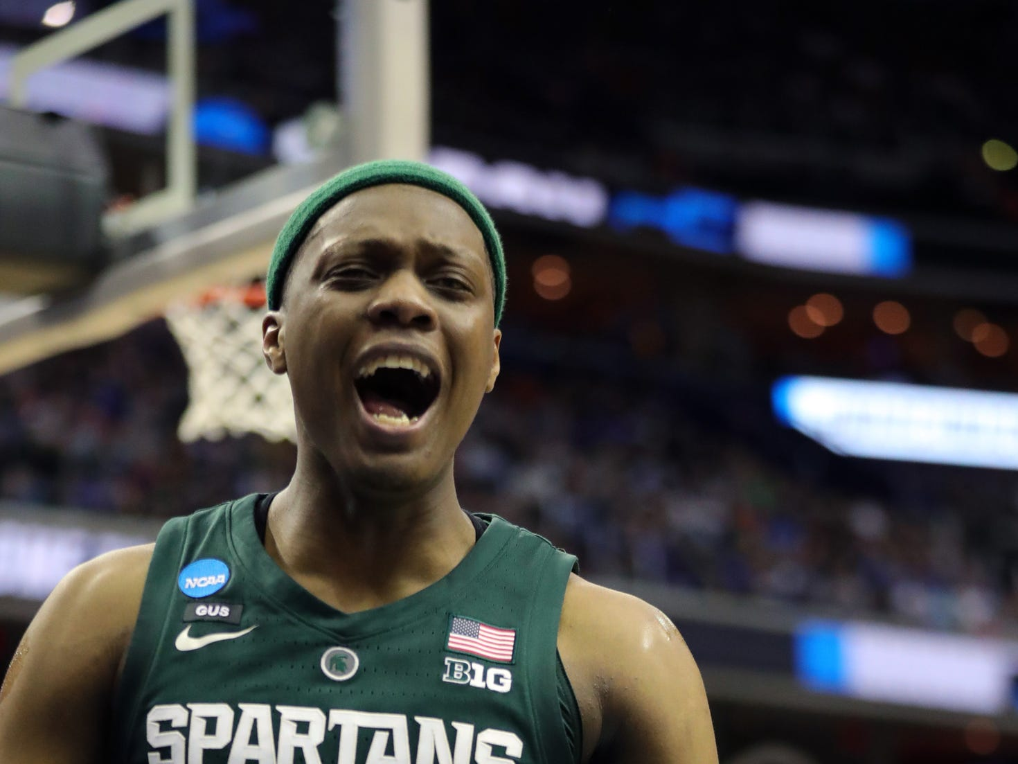 Michigan State guard Cassius Winston reacts after a basket against Duke during the first half of the NCAA tournament East Region final on Sunday, March 31, 2019, in Washington.