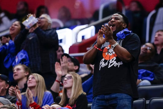 A Pistons fan cheer for Isiah Thomas as he's introduced during the first half of Pistons-Trail Blazers game at the Little Caesars Arena in Detroit, Saturday, March 30, 2019.