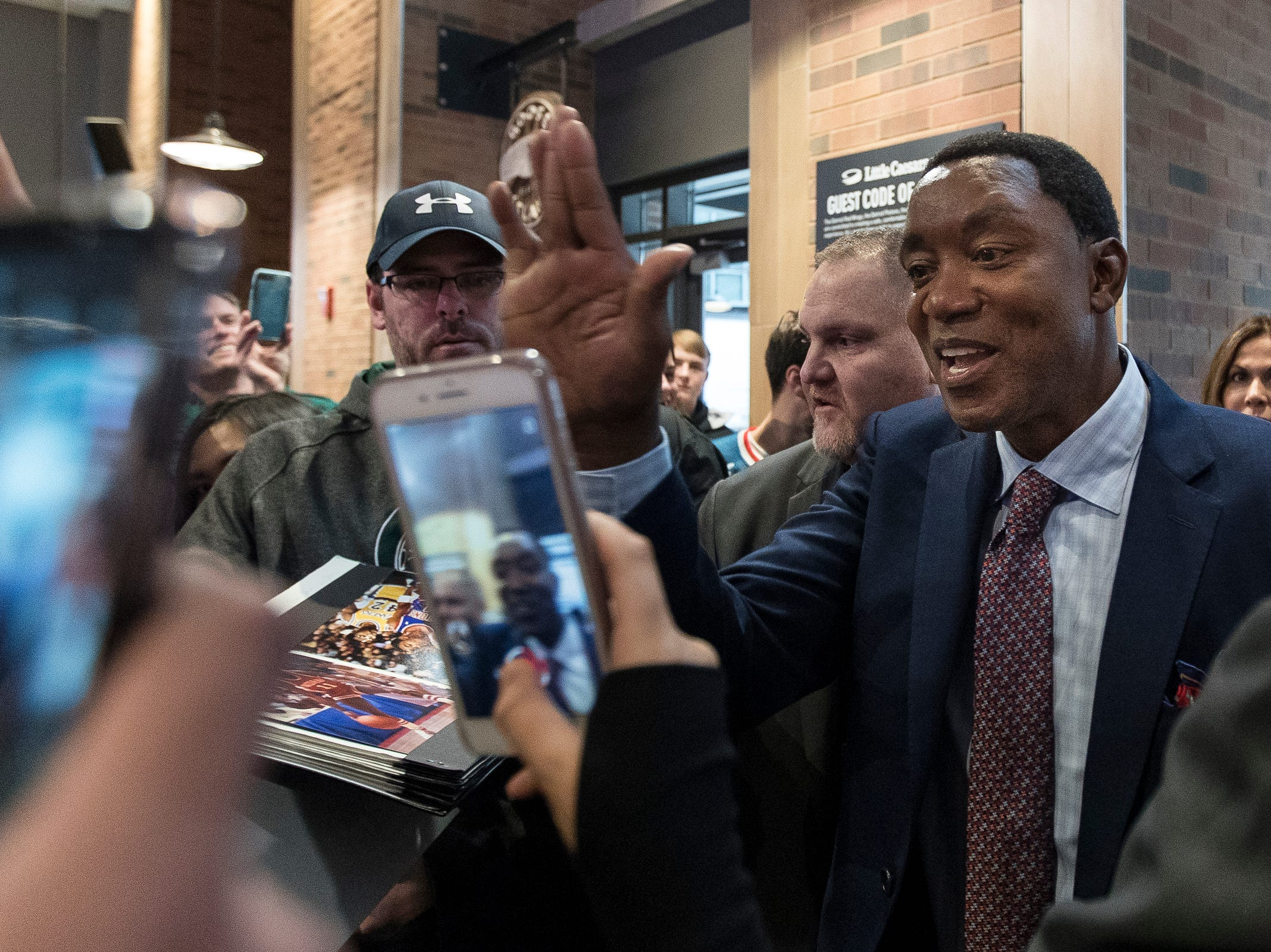 Isiah Thomas high fives fans before the Pistons-Trail Blazers game at the Little Caesars Arena in Detroit, Saturday, March 30, 2019.