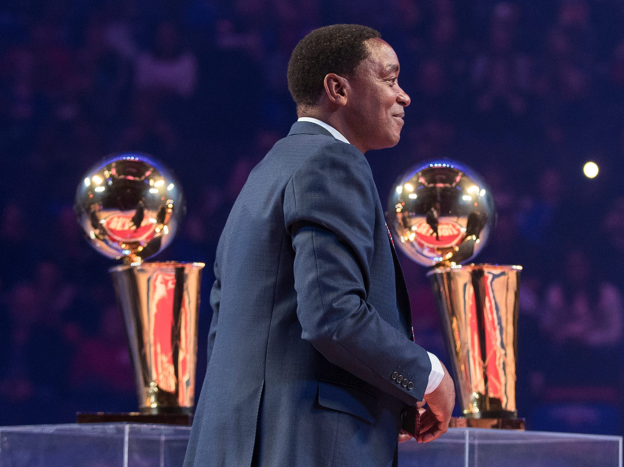 Isiah Thomas walks by the championship trophies during the Pistons' ceremony for the 30th anniversary of the 1989-90 back-to-back championships during the Pistons' 99-90 win over the Trail Blazers on Saturday, March 30, 2019, at Little Caesars Arena.